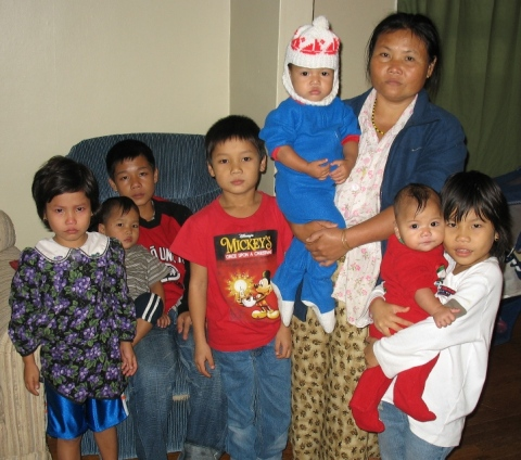 Refugee mother and children helped by Taking Root program